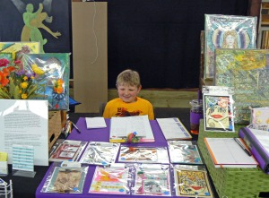 My sweet grandson helping in my booth